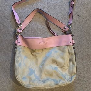 Coach purse with pink leather detailing